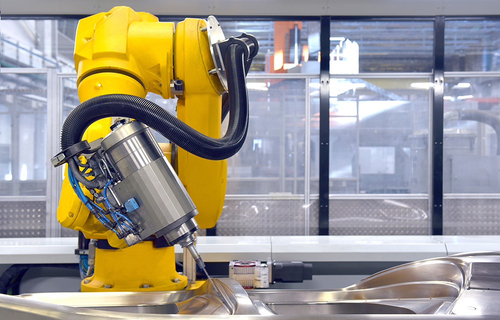 Stäubli TX200 robots with spindle at Audi
